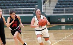 Dribbling down the court, senior Chandler Browning looks to make a pass. The Lady Eagles started in the lead, but took a loss from Rockwall Heath in the end. The final score was 32-36.