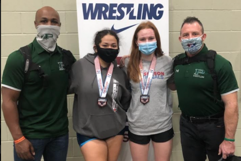 Gathering after their matches, junior Maegan Flaherty and senior Delia Luna stand alongside coaches Tony Cooper and Sion King. Luna placed 4th and Flaherty placed 5th in their weight classes. The girls and boys team competed in the USA Wrestling Preseason National Tournament in Des Moines, Iowa, with senior LJ Richardson placing 5th and senior Chase Parham placing 8th for the boys