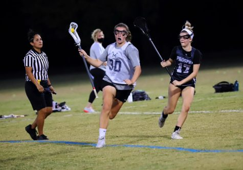 Playing her defense, No. 17 Olivia Frye follows her opponent who has the ball. Olivia plays midfield for the Prosper team. Frye will be attending Rockhurst University in the fall. Their lacrosse team is a part of the Great Lakes Valley Conference.