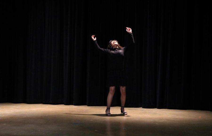 """Highlighted by the light, senior Charlize Fedele sings """"Rose's turn"""" from Gypsy. Fedele's solo musical won at the state competition and she will be moving on to nationals. """"I have been competing since my junior year in ITS,"""" Fedele said. """"Last year, I played Euridice, in a group acting event, and our group won. I am currently competing in the solo musical category and it is very different from being with a group but still very rewarding."""""""