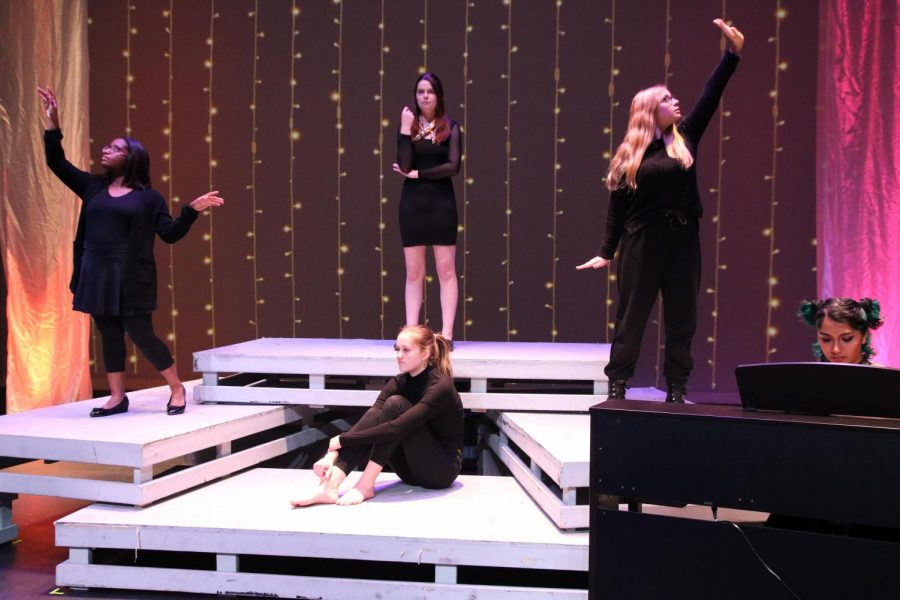 In their starting poses, junior CC Langston, junior Marlee Parish, junior Lizzie Myers, sophomore Madeleine Wentz, and junior Charlie Yohannan, set up before beginning their song about manic. The group of combined production and musical students performed Clementine by Halsey, under the Mental Health category.