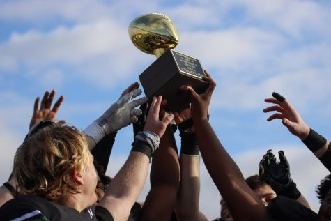 Displaying their trophy for the team, the Eagles celebrate their win. The