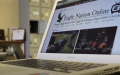 The front page of Eagle Nation Online shines on writer Emma Hutchinson's laptop. The online newspaper is student-led and focuses on publishing at least once a day. For updates on the school and community, check out ENO's Instagram, Twitter, and Facebook profiles.