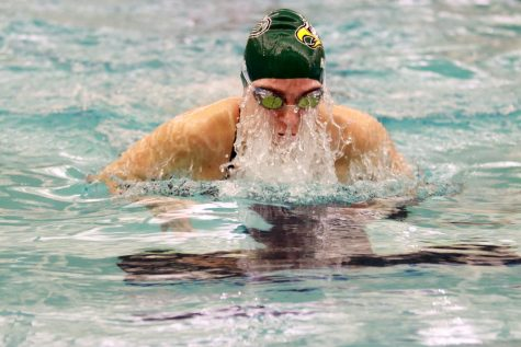 Emerging from the water, senior Jocelyn Hayes takes a breath of air between her breaststroke-strokes. Hayes competed in the 200-yard individual medley event, and swam two different relays as well. This is Hayes