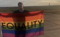 Sophomore Taylor Holcomb stands with his equality pride flag at his home. This column discusses how the media impacts LGBTQ+ viewers. LGBTQ+ representation means a lot to me, Holcomb said, Its helped me to come out and be proud of who I am.
