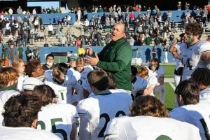 Speaking to the team, head coach Brandon Schmidt talks to the Eagles after their loss to Denton Guyer.