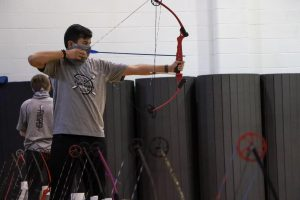 As he lines up the shot, junior Sam Sidhu steadies his bow. Sidhu competed in the national competition during his freshman year, but his sophomore year nationals were cancelled due to COVID-19.