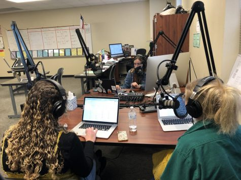 """While seniors Maddie Moats and Caroline Wilburn speak into the mic, Junior Christi Norris records the latest episode of the """"Best of SNO"""" winning podcast History"""