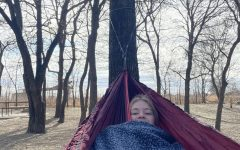 In Light Farms Constellation Park, senior Maddie Moats hammocks between the trees Dec. 28. She went with her friend, senior Reagan Newton, and they shared the hammock as they listened to their favorite music. Moats especially enjoyed the song