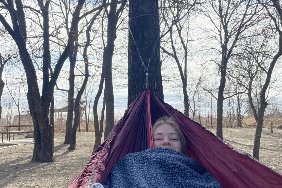 "In Light Farms Constellation Park, senior Maddie Moats hammocks between the trees Dec. 28. She went with her friend, senior Reagan Newton, and they shared the hammock as they listened to their favorite music. Moats especially enjoyed the song ""Figure 8"" by Peach Pit on this day."