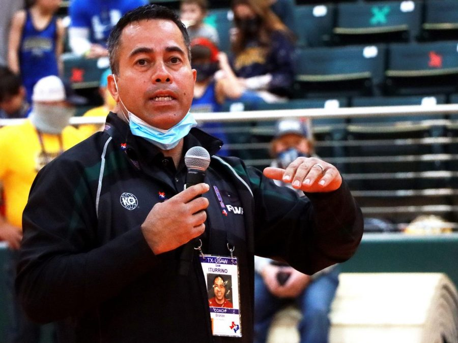 Prosper Wrestling Academy head wrestling coach Sam Iturrino explains the rules and guidelines of the USA wrestling tournament on Saturday, Jan. 16 in the Prosper Arena. The local academy hosted the tournament that had more than 700 wrestlers from around Texas and the country. Prosper Wrestling Academy was founded in 2020 when Rock Hill High School opened and the only club wrestling team in Prosper became affiliated with Rock Hill, leaving Prosper High School without a  club to train the up-and-coming wrestlers until the new academy opened.