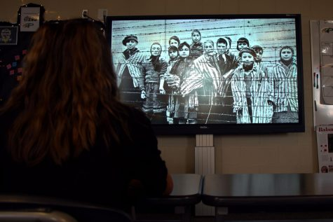 As she sits at her desk, senior Emma Hutchinson  stares at an image from the Holocaust posted on the BBC website. Holocaust Remembrance Week is held Jan. 25-27, with special curriculum designed by the district.