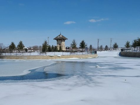 Coated in ice, the pond at the front of the Star Trail neighborhood development in Prosper sits peacefully blanketed in snow. Last week, large sections of Texas were hit with a snowstorm that caused power outages and water issues. In Prosper, the entire school district was closed Feb. 11-19.