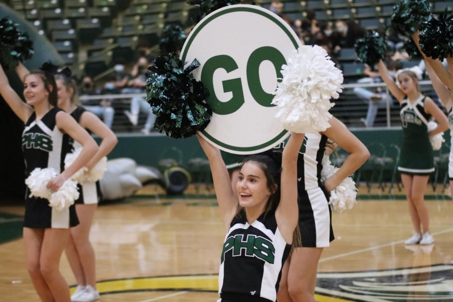 With her sign in the air, senior Jaiden Gonzalez performs a cheer routine. The high school cheerleaders recently competed at the 6A UIL State Championship. They placed sixth.