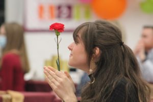 "Clapping for the new inductees, Madison Woodard shares the society flower, a red carnation, with them. Woodard is a former member of National Art Honor Society who earned ""Gold Seal"" at the Texas Art Education Association Visual Arts Scholastic Event four years ago with her piece called ""Sea Dragon.""  Former students, their parents, as well as district staff attended the  ceremony. ""I thought we were able to make it more elegant this year with the table settings,"" sponsor Judy Seay said. ""For me, that kind of compensated for what we missed out on as far as personal togetherness. I felt like we were able to compensate by going into slightly more elegant settings with tablecloths and centerpieces. It was more like a banquet as opposed to receptions."""