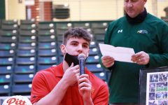 Pulling his mask down, senior Ryan Medeiros thanks all of the people who helped him to achieve his goals academically and athletically. Medeiros played as a safety for Prosper and will continue his football career at Pittsburgh State University in the fall.
