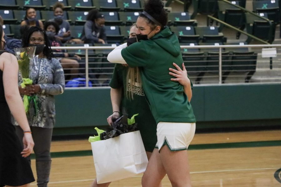 Embracing, junior Saylor Lewis gives senior Emma Bish a gift in honor of senior night. Bish has played basketball for Prosper since seventh grade. Lewis has played since her freshman year.