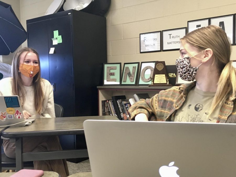 Two members of Eagle Nation Online, editor-in-chief Grace Williamson and journalist Maddie Moats, talk to each other while wearing masks. Students are used to wearing required face coverings, especially since students are already halfway through the second semester of the 2020-2021 school year.