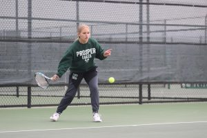 As she prepares to hit a forehand, senior Brooke Hallauer keeps her eye on the ball. The team played in the Rock Hill Invitational tournament and competed against teams from the surrounding areas. Next week, the team competes in the McKinney two-day tournament Feb. 12-13.