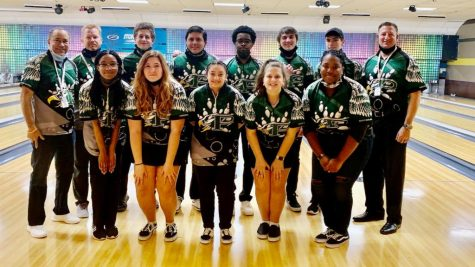 "After their second game of the season, the Prosper Bowling Team gathers in front of the lanes at the Plano Super Bowl. Their last competition took place March 20. Pictured here is Coach Mickie Tate, Coach Daniel Simons, Aaron Coleman, Roman Salinas, Jayden Okwesa, Dylan Bell, Noah Nelson, and Coach David Coleman in the top row. The bottom row holds Naiya Okwesa, Chesney Stinnett, Sydney Topper, Ashley Coleman and Hailey Herron. ""My favorite part about the team is the team itself,"" Herron said. ""Everyone was so welcoming, and they are some of my best friends."""
