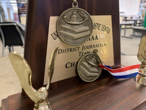 Displayed on a desk in the journalism news room, the UIL journalism district champion trophy sits with other UIL medals from this year. UIL academic teams competed on Friday, March 26 and Saturday, March 27. As of right now, Prosper will win the district championship.