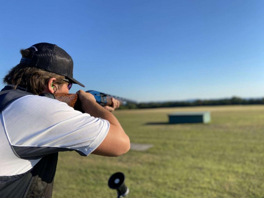 Aiming down the field, sophomore Brett Kemper shoots at his targets. Students started their season in November and continued into the spring semester.