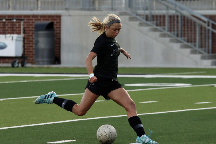 Preparing to kick the ball, senior Kaitlyn Giametta runs toward the goal. She scored the first goal of the game with an assist by Hadley Murrell. Giametta also plays club soccer for FC Dallas.
