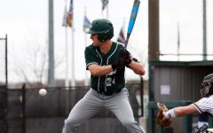 Waiting for the ball, junior Jacob Devenney prepares to swing his bat. Devenney is a two sport athlete, playing on both varsity baseball and football. Devenney has committed to play baseball at Rice University in the fall of 2022 after he graduates from Prosper.