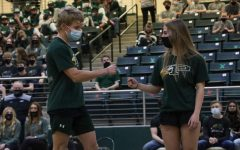 """At the spring Meet the Eagles, senior twins Sydney and James Duvall give each other a fist bump as their names were announced. Both have competed in powerlifting for all four years. """"Sydney and James have a very unique relationship,"""" Coach Brian Thompson said. """"They can be at complete dismay and upset with each other, and at other times, they get along great. I've had to make them stop arguing with each other several times and get on to them like a parent. However the one thing that never changes is the support they have for each other."""""""