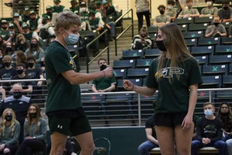 """At the spring Meet the Eagles, senior twins Sydney and James Duvall give each other a fist bump as their names were announced. Both have competed in powerlifting for all four years. """"Sydney and James have a very unique relationship,"""" Coach Brian Thompson said. """"They can be at complete dismay and upset with each other, and at other times, they get along great. I"""