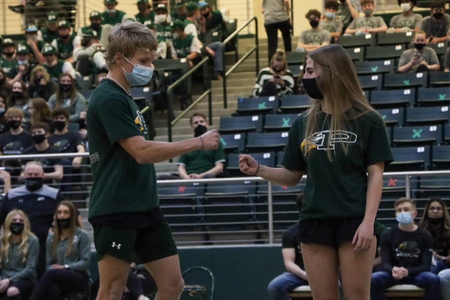 At+the+spring+Meet+the+Eagles%2C+senior+twins+Sydney+and+James+Duvall+give+each+other+a+fist+bump+as+their+names+were+announced.+Both+have+competed+in+powerlifting+for+all+four+years.+%E2%80%9CSydney+and+James+have+a+very+unique+relationship%2C%E2%80%9D+Coach+Brian+Thompson+said.+%E2%80%9CThey+can+be+at+complete+dismay+and+upset+with+each+other%2C+and+at+other+times%2C+they+get+along+great.+I%27ve+had+to+make+them+stop+arguing+with+each+other+several+times+and+get+on+to+them+like+a+parent.+However+the+one+thing+that+never+changes+is+the+support+they+have+for+each+other.%E2%80%9D