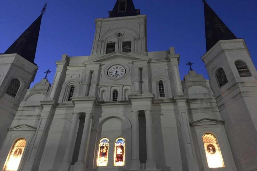 Illuminated against the night sky, the St. Louis Cathedral stands proudly in the heart of the French Quarter of New Orleans. It's known for being the oldest cathedral in the United States.
