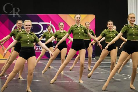 Smiling to the judges, senior Talonette officer Reagan Newton, freshman Lauren Richey and senior Talonettes captain Zoe Dale finish off the jazz dance. The team won the Super Sweepstakes award and was Grand Champion for the large division. Overall, the team won third place.