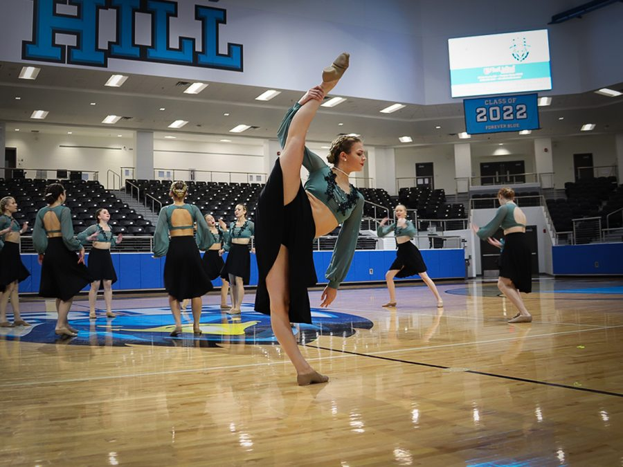 Doing a leg hold tilt, sophomore Mady Grobe performs a short solo during the Talonettes Elite contemporary dance. At the Talonette's last competition of the season, Grobe placed fourth with her individual solo. The Talonettes competed at their final competition of the season on Saturday, March 20.