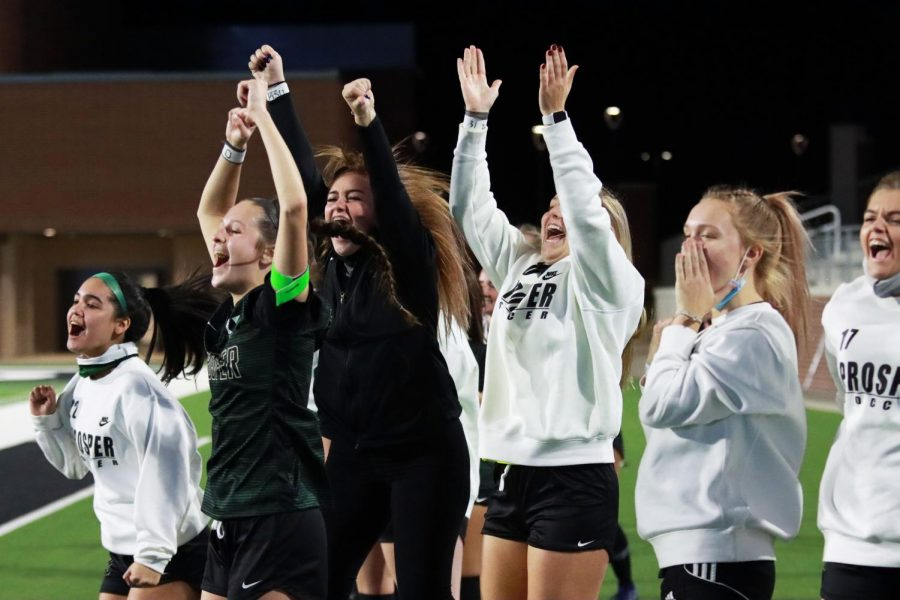 Cheering for their teammates, the girls varsity soccer team celebrates a goal. The team is rated No. 2 in the nation by United Soccer Coaches. Prosper will play Coppell during their first playoff game at Mckinney Independent School District