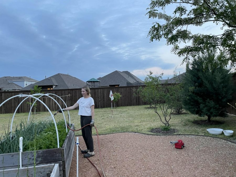 This week, Earth Day takes place, as Prosper mother Tracey George waters her plants in her garden. George