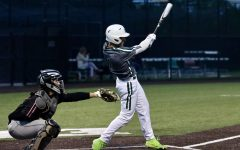 Hitting a home run, junior Jacob Devenny swings his bat in the second inning. Devenny plays both football and baseball. He is committed to Rice University to play baseball.