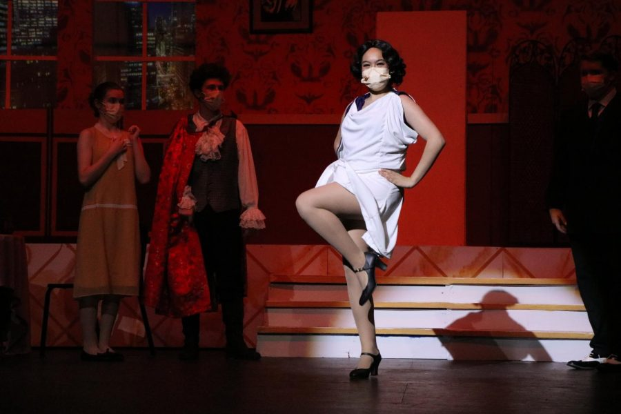 Stealing the stage, senior Charlize Fedele kicks through her big number