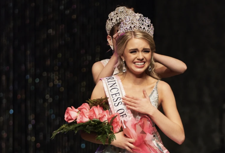 Standing in shock, junior Danielle Walls is crowned with the title of Teen Miss Princess of America at the Princess of America national beauty pageant in November 2020. This was only Walls' second time competing in a beauty pageant.