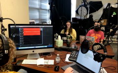 In an image taken by journalism advisor, Lisa Roskens, seniors Caroline Wilburn, Emma Hutchinson, and junior Christi Norris record the latest episode of History's Forgotten. In this episode, the team discusses the history of Earth Day, held on April 22. Started in 1970, Earth Day began as a way to educate students about the planet.