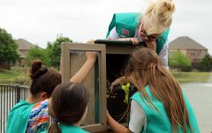 "Working with her fellow Girl Scouts, Girl Scout Carsyn Overstreet holds the drill. After buying the supplies, the girls built the Little Free Library together and installed it on Tuesday, April 27. ""The premise that the girl initially got started with was to reduce, reuse, recycle,"" Girl Scout leader Kalli Overstreet said. ""They came up with a ton of different options and one was to reuse books, since we all had books. We got in contact with the local neighborhood here, and the HOA and it just kinda spawned."""