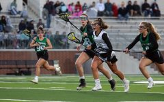 Storming across the turf, freshman Gretchen Teigen rushes past Southlake defenders. The game closed 18-6 with Prosper in the lead.