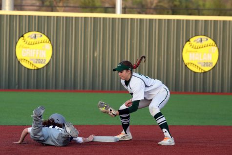 """Dropping down, junior Ayden Allen catches the ball, preventing the opposing team from stealing the base. Allen has been on softball for three years. """"I think the team has been performing really well this season."""" Allen said. """"We have very high goals and expectations for our team this year, and we are all super excited."""""""
