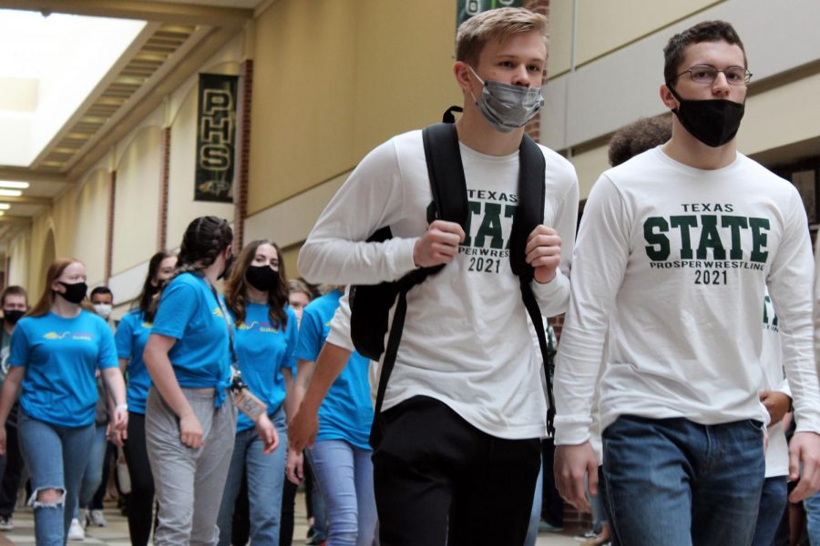 Wrestlers and seniors Austin Gordon and John Richardson walk down the hall in the send off April 23. The send off honored clubs, sports and academic teams that qualified for state and national competitions. Wrestling freshman Joseph Richardson, senior John Richardson, senior Chase Parham and junior Taylor Martinez will compete at the 6A state championship.