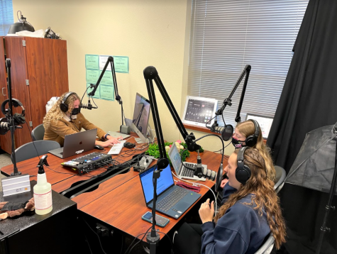 In an image taken by Neena Sidhu, seniors Caroline Wilburn, Maddie Moats and Christi Norris record the final episode of Historys Forgotten. In this episode, Wilburn, Moats and Norris discuss the life of Rachel Carson. Carsons work made a lasting impact on the environmental science industry, and her published books brought awareness to the harmful affects of pollution.