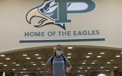 Pausing for a moment in the school foyer, sophomore Claire Moore reflects on moving to Prosper from Orlando this past April. Now, she prepares for her junior year at a new school.