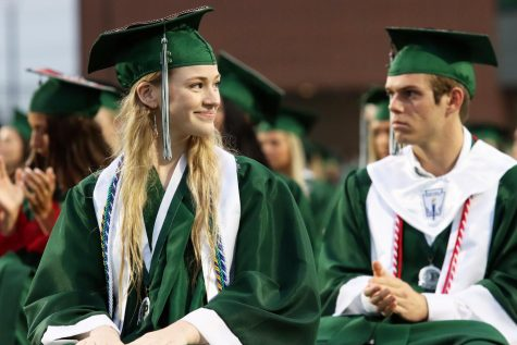 Head turned, senior Madelyn Moats smiles at the student beside her. Moats graduated in the top ten percent of her class. While at Prosper High School, Moats was a journalist for Eagle Nation Online, writing several articles and co-hosting a history podcast titled History