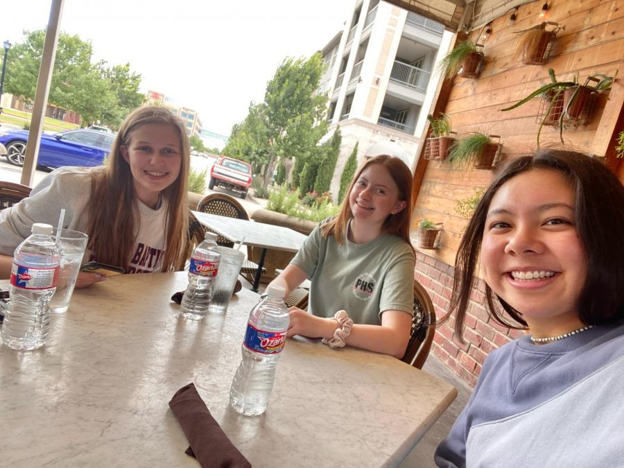 At Pizzeria Testa, seniors Gabriella Winans, Amanda Hare and Tiana Albino eat lunch after watching Black Widow at the Cinemark movie theater. They watched the movie on the first day it came out, Friday, July 9. I loved the movie, Hare said. I was very excited for it, and it definitely lived up to my expectations.
