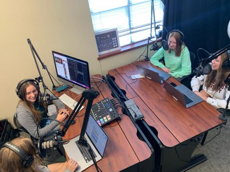 Before recording, seniors Christi Norris, Alyssa Clark, Amanda Hare and Gabriella Winans prepare for the first episode of their podcast, Over the Popcorn Bowl. They created the podcast to discuss movies and TV shows. In this episode, they talked about the new Black Widow movie by Marvel studios.