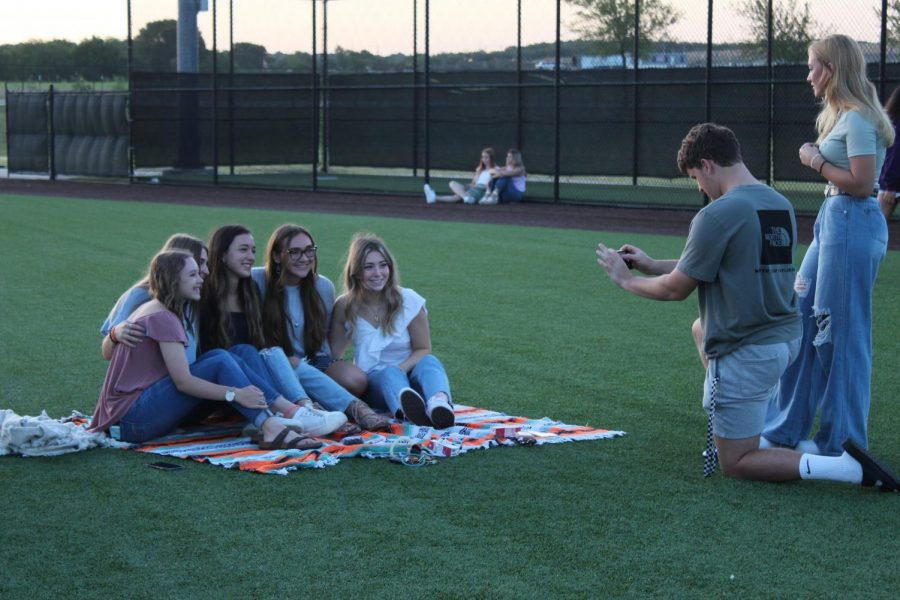 As Elisna Terblanche watches, senior Scott Frederick takes a picture of some friends. The photo includes seniors Makenna Brandvold, Ashley DAngelo, Ailee McFarland, Lauren Torok and Kaitlyn Lakins. It was a fun way to kick off my senior year, Brandvold said. It was fun to catch up with a lot of people I hadnt seen in a while.